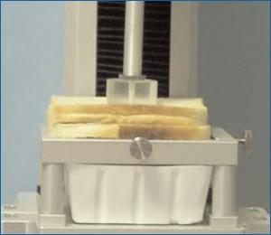 Sliced bread on a texture analyzer stand