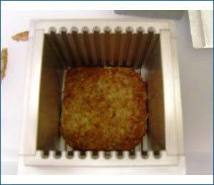 Ground meat sample within test cell