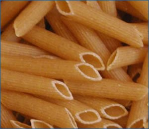 Close up uncooked penne pasta